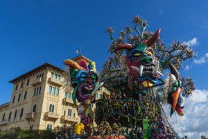 Allegorical wagon during carnival parade with big masks, Viareggio, Italy