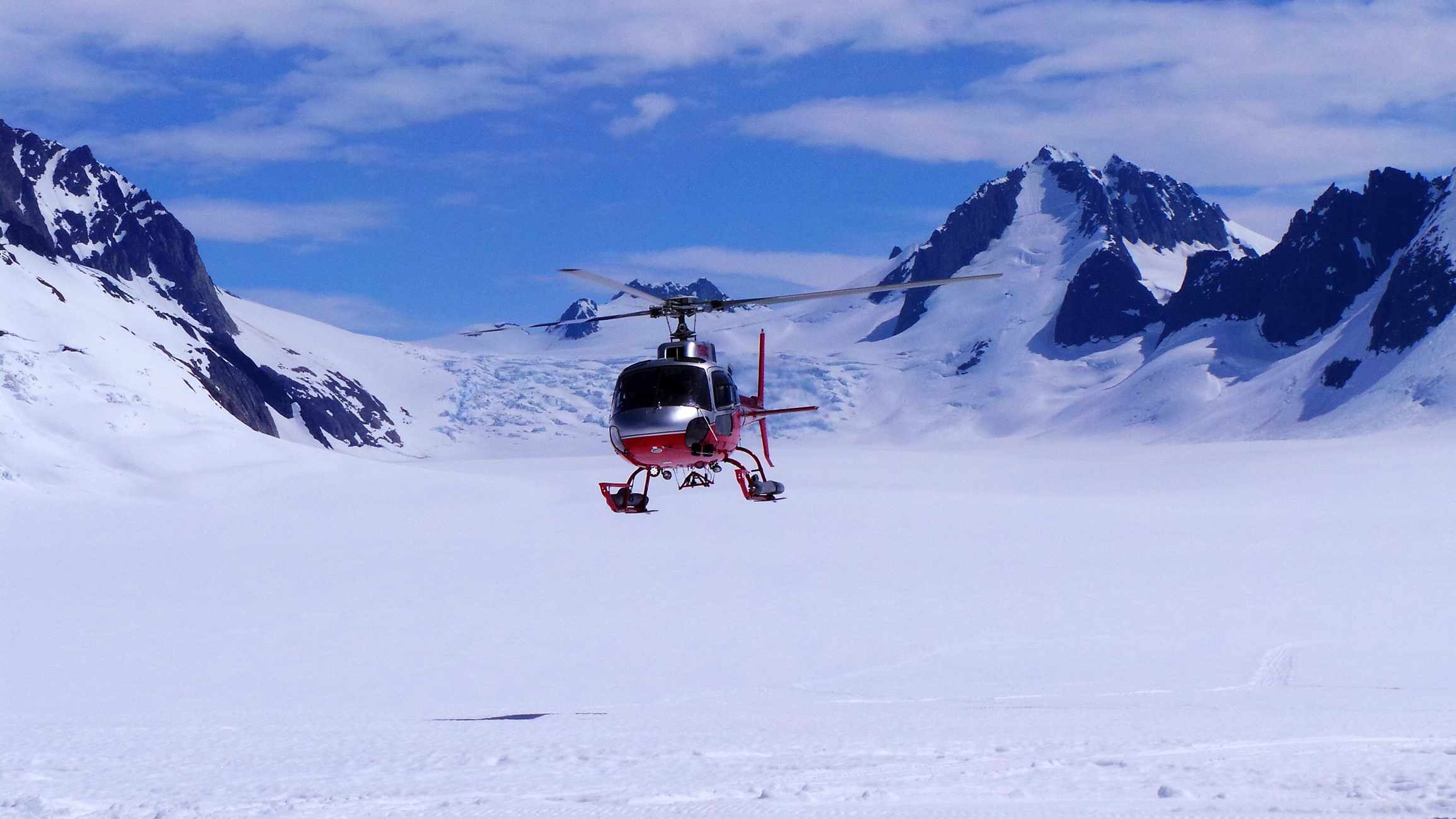 Helicopter On Snow Covered Landscape
