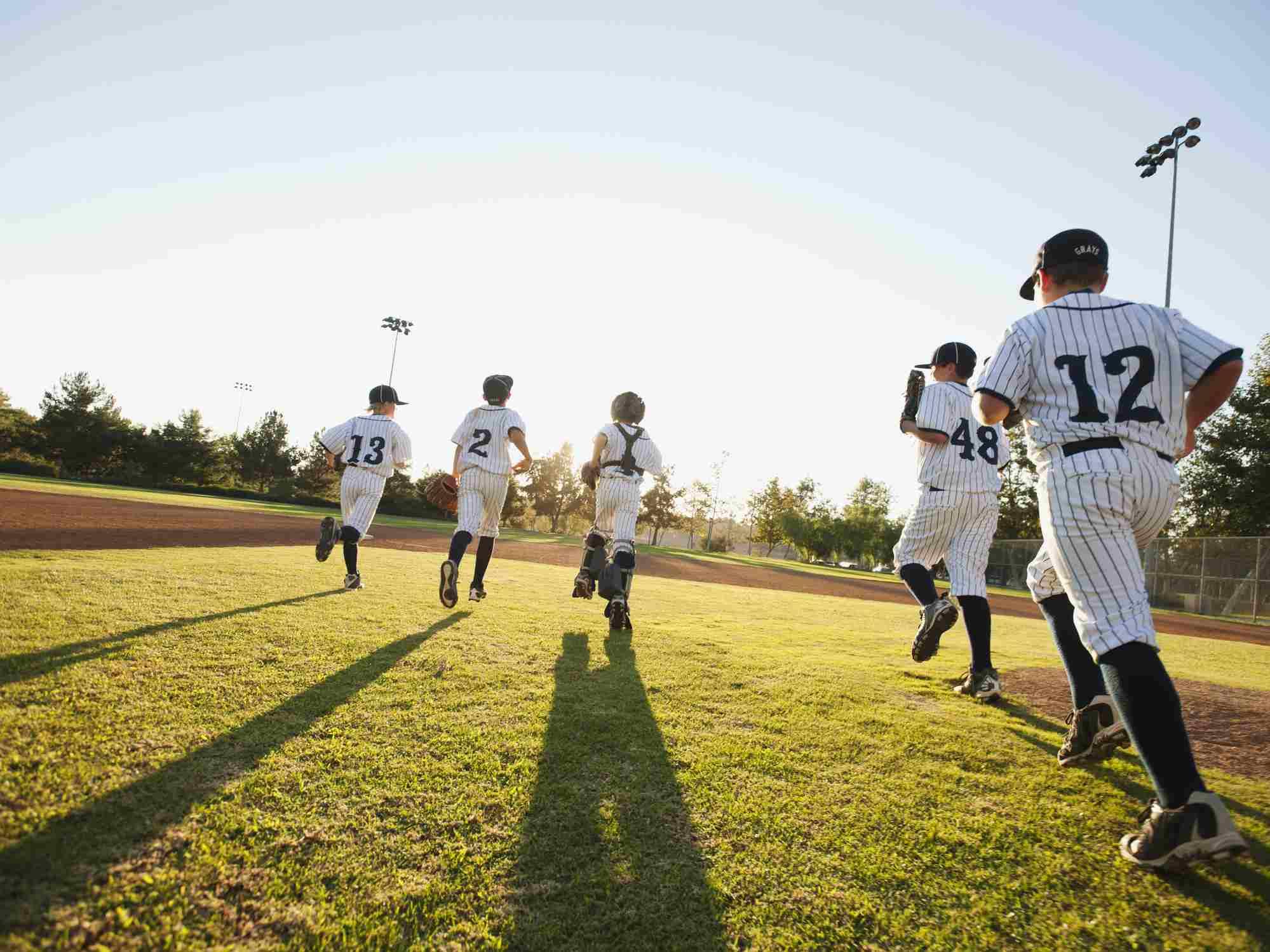 Baseball players running on baseball diamond