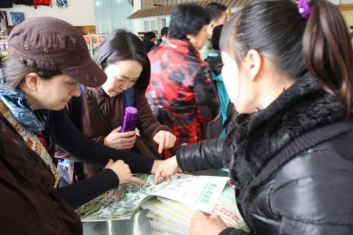 Buying maps at the visitor center at the foot of Huangshan.