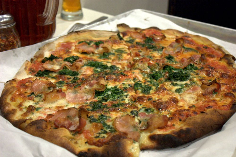 Red bacon spinach pizza at Frank Pepe Pizzeria Napoletana