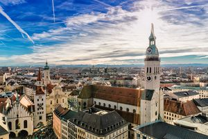 Cityscape of Munich with Alps in the background