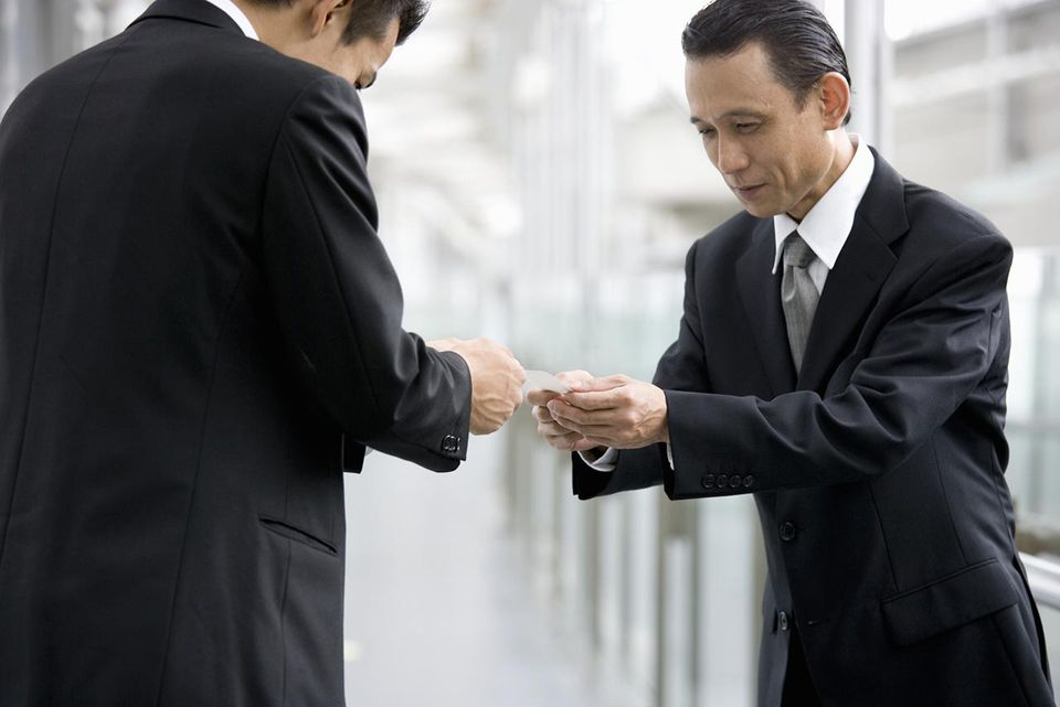 Cultural gap tips for business travelers two businessmen exchanging business cards m4hsunfo