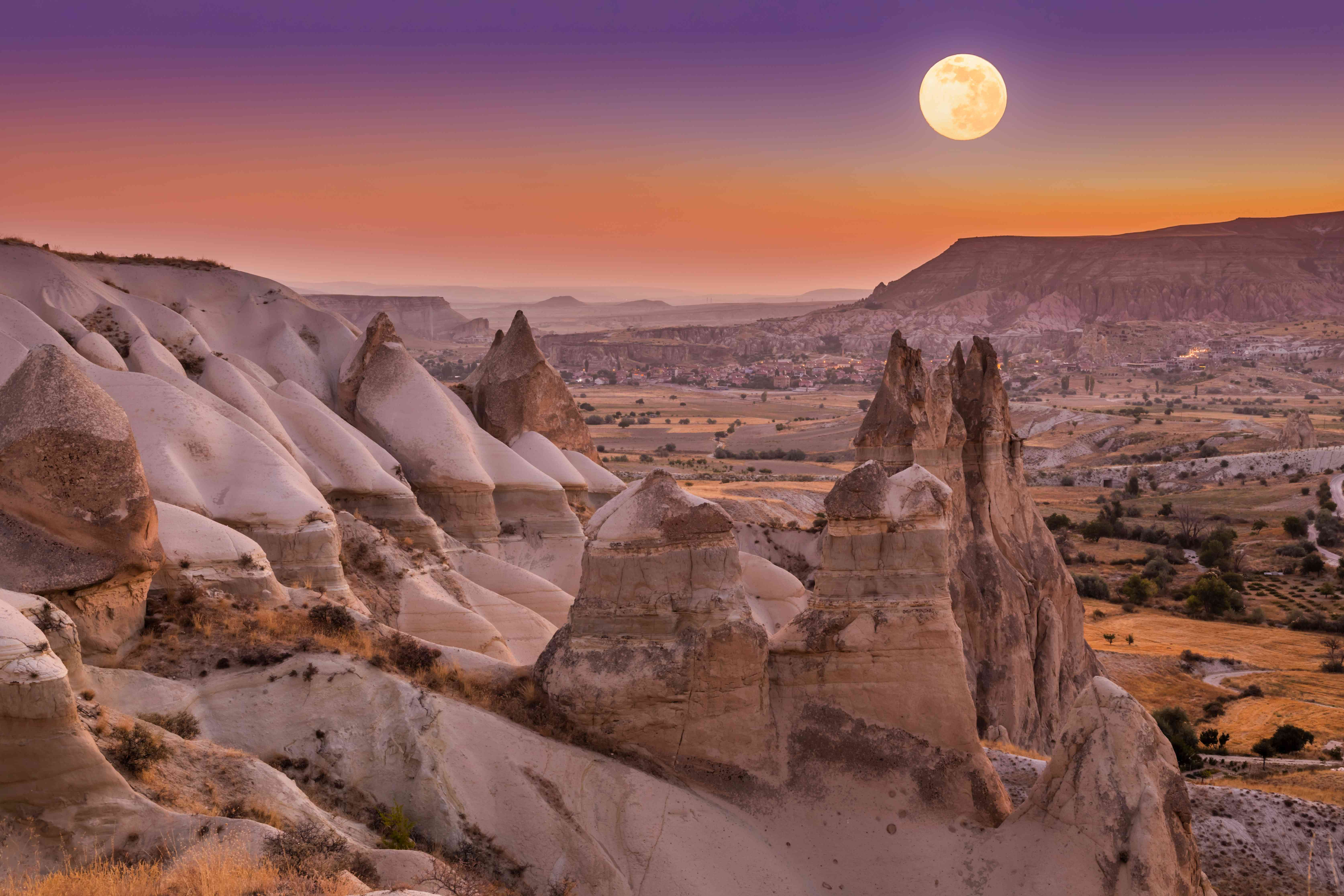 Full Moon over the rock formations of Love Valley in Cappadocia, Turkey