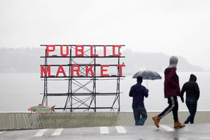 People walk in foggy conditions near Seattle Pike Place Market