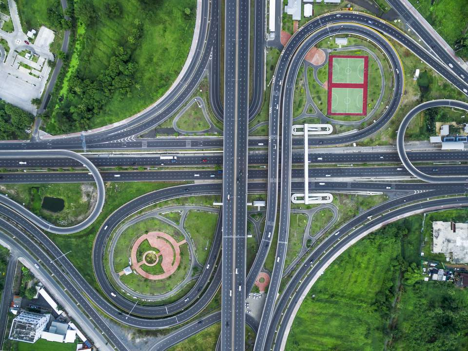 Aerial view of busy intersection jug handles .