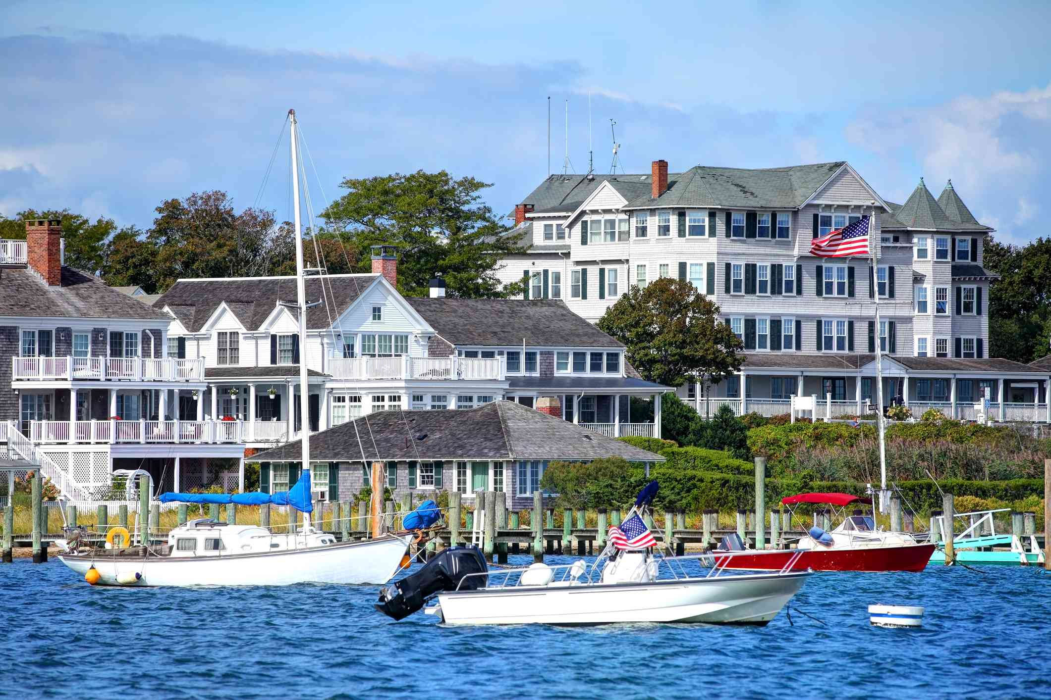 boats in a harbor with large greek revival-style houses in Edgartown, Martha's Vineyard