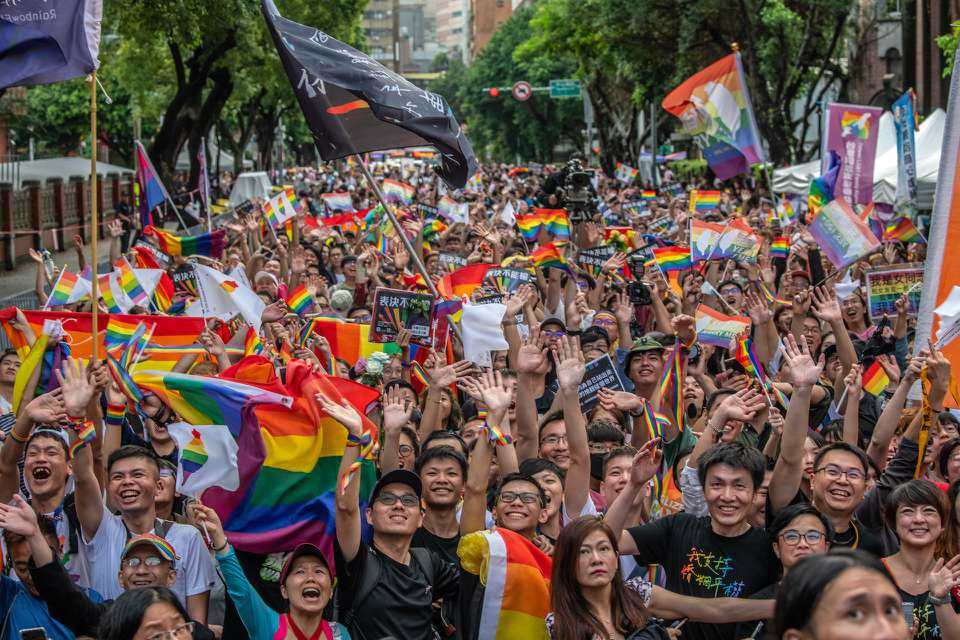 Marchers in Taipei waving pride flags