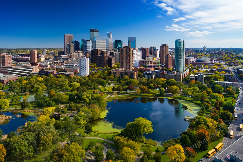 Minneapolis aerial with Downtown Minneapolis skyline in the background and Loring Park with Loring Pond in the foreground