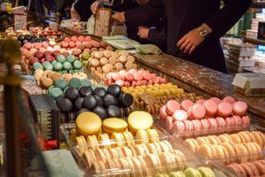 Rows filled with different flavored macrons