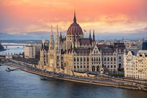 The Hungarian Parliament on the Danube River at Sunset in Budapest, Hungary