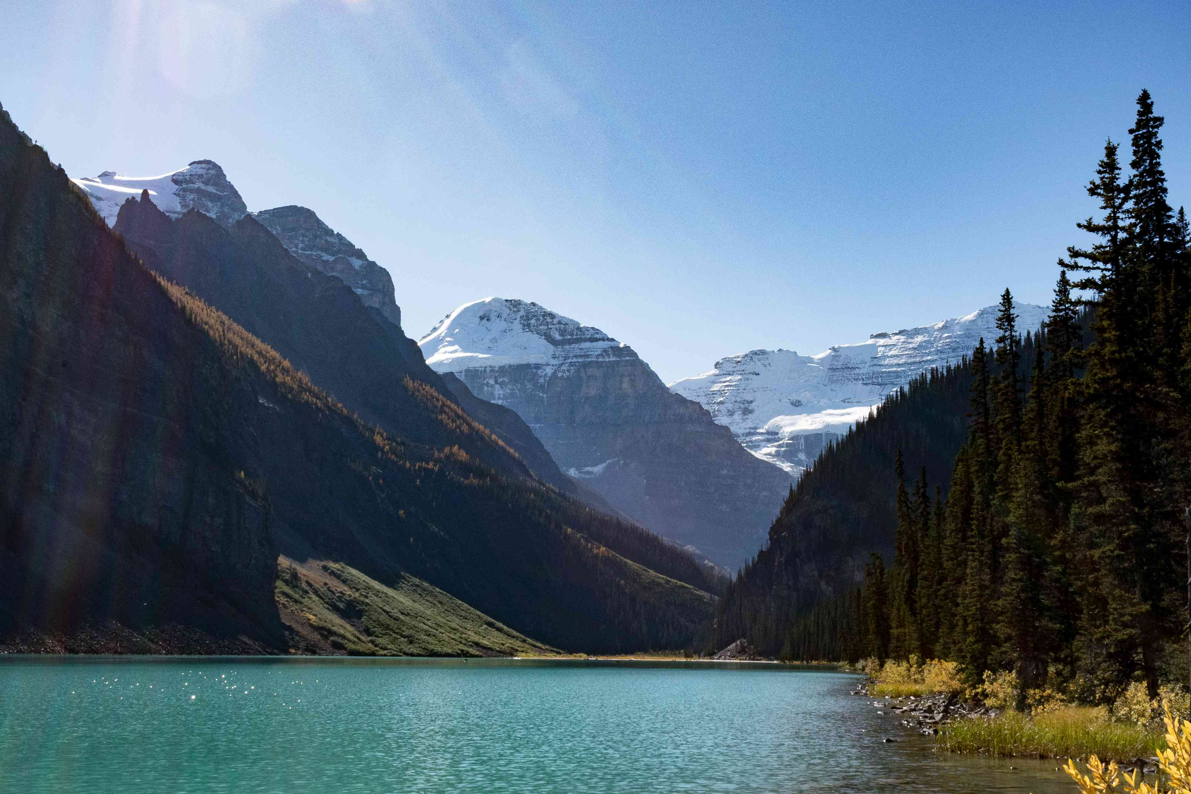 Scenic view of mountains around Lake Louise on a sunny day