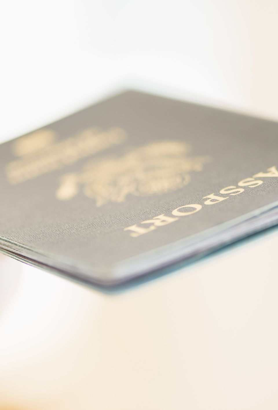 Close up of woman's hand holding passport