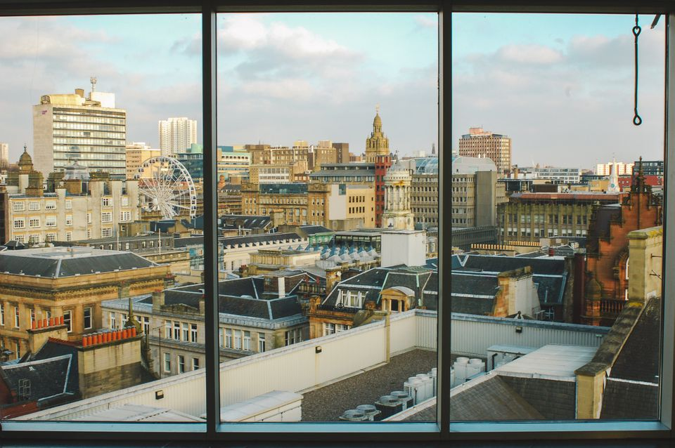 View of Glasgow cityscape through a window
