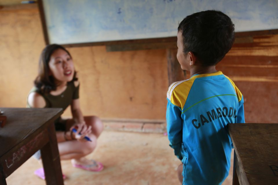 Volunteer teaching in Cambodia school
