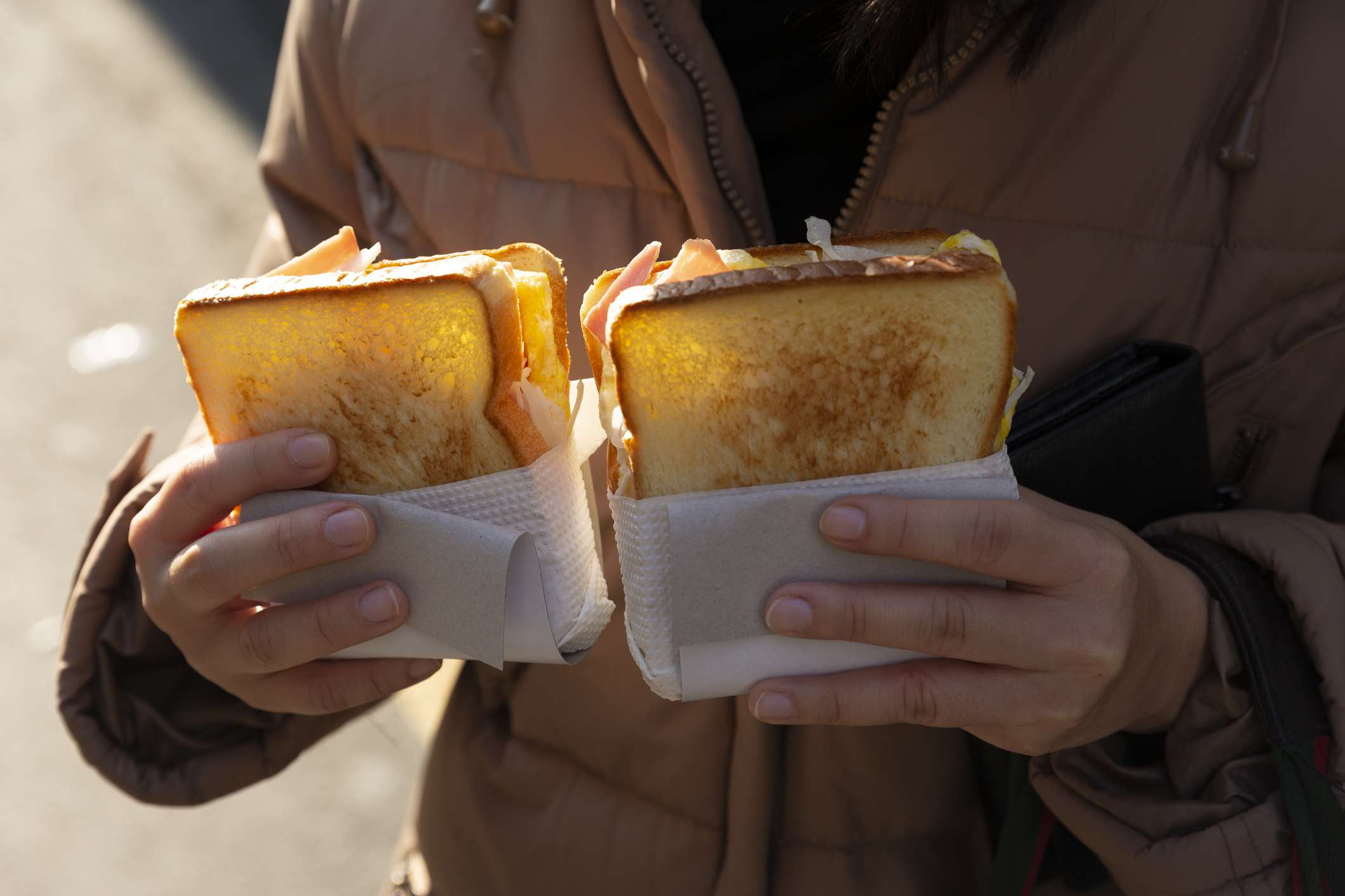 Hand holding South Korean style sandwiches,South Korea street food