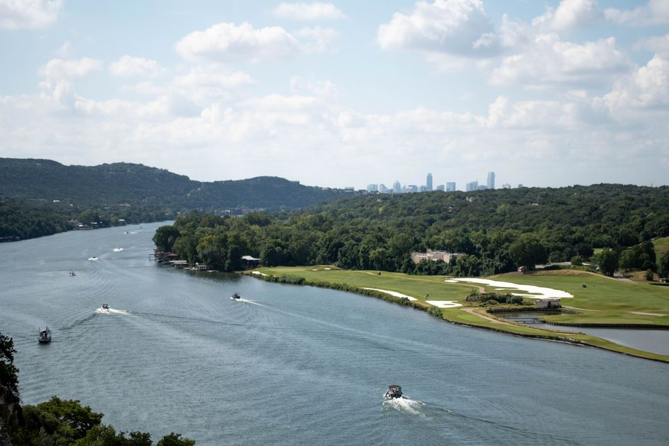 Boats cruising down Lake Austin