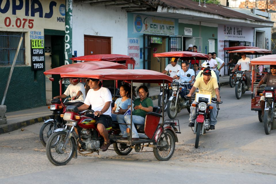 Mototaxis and motorbikes dominate the traffic of the tropical Amazon city of Tarapoto.