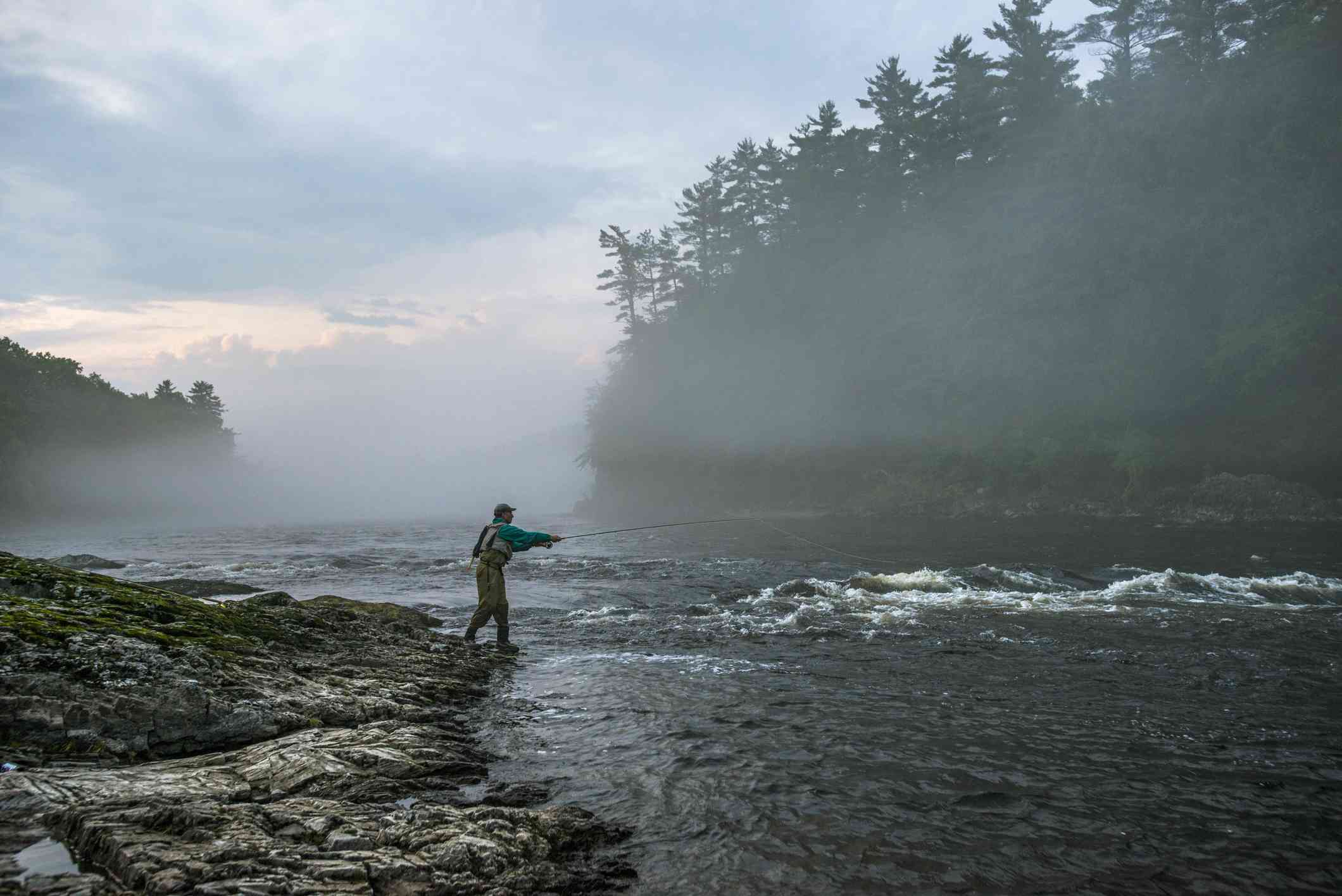 Fly fisherman on the Kennebec River, Maine.