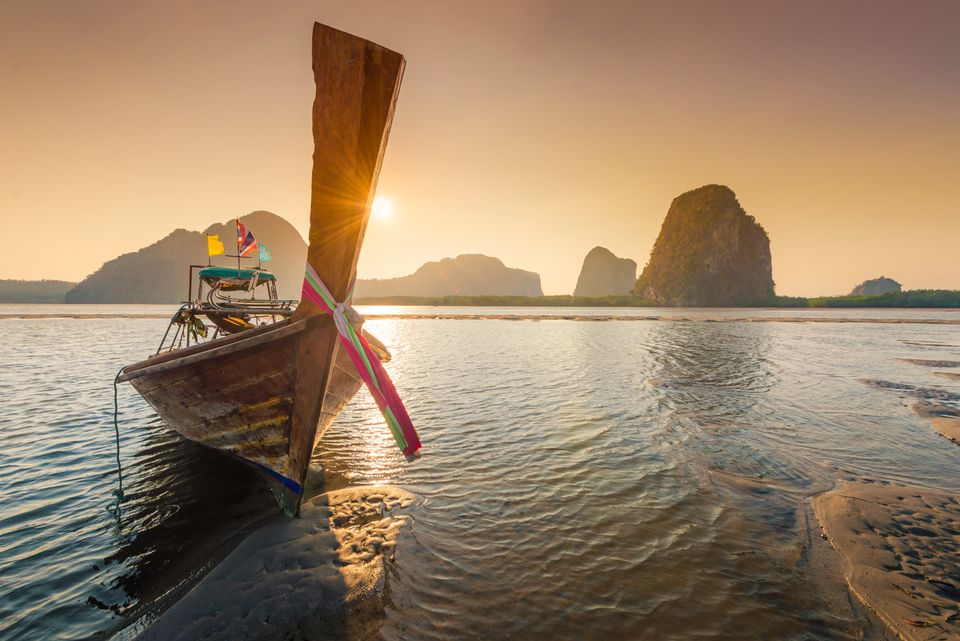 Longtail boat and islands for a vacation in Thailand