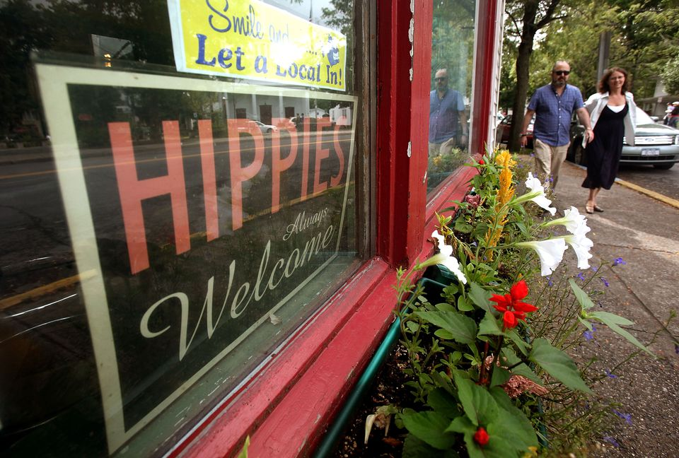 A 'Hippies Always Welcome' sign sits in a window in Woodstock, New York.