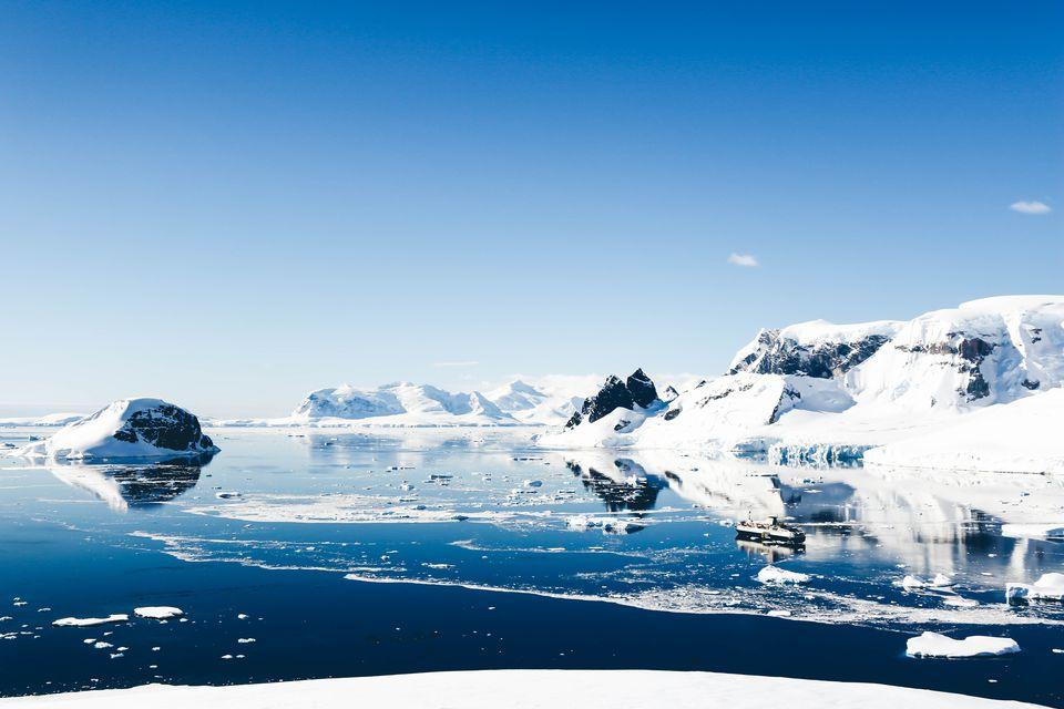 scene of icebergs on the ocean