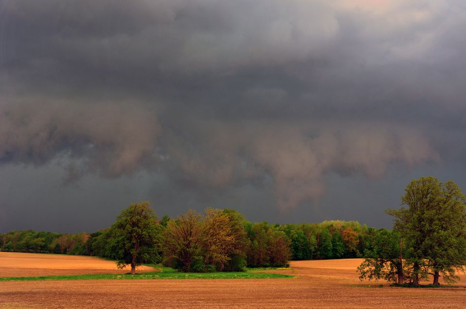 Storm clouds hang over fields in Fostoria, Michigan