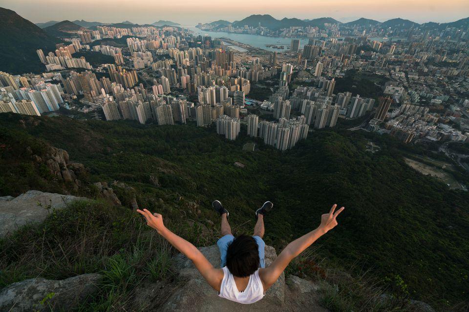 Hiker viewing high density residential blocks in Hong Kong