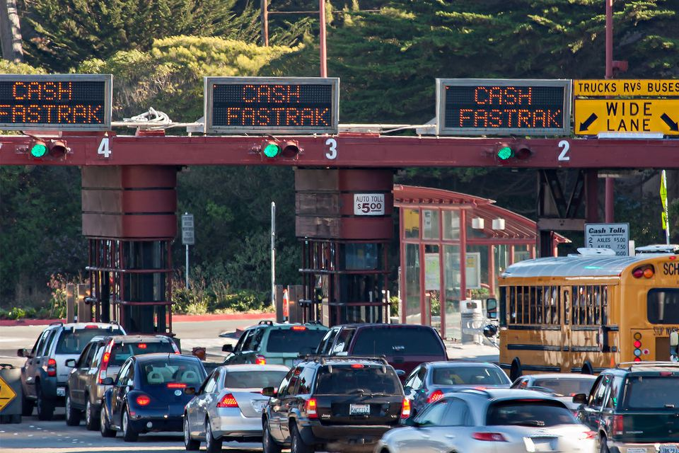 cars at the golden gate bridge toll gate
