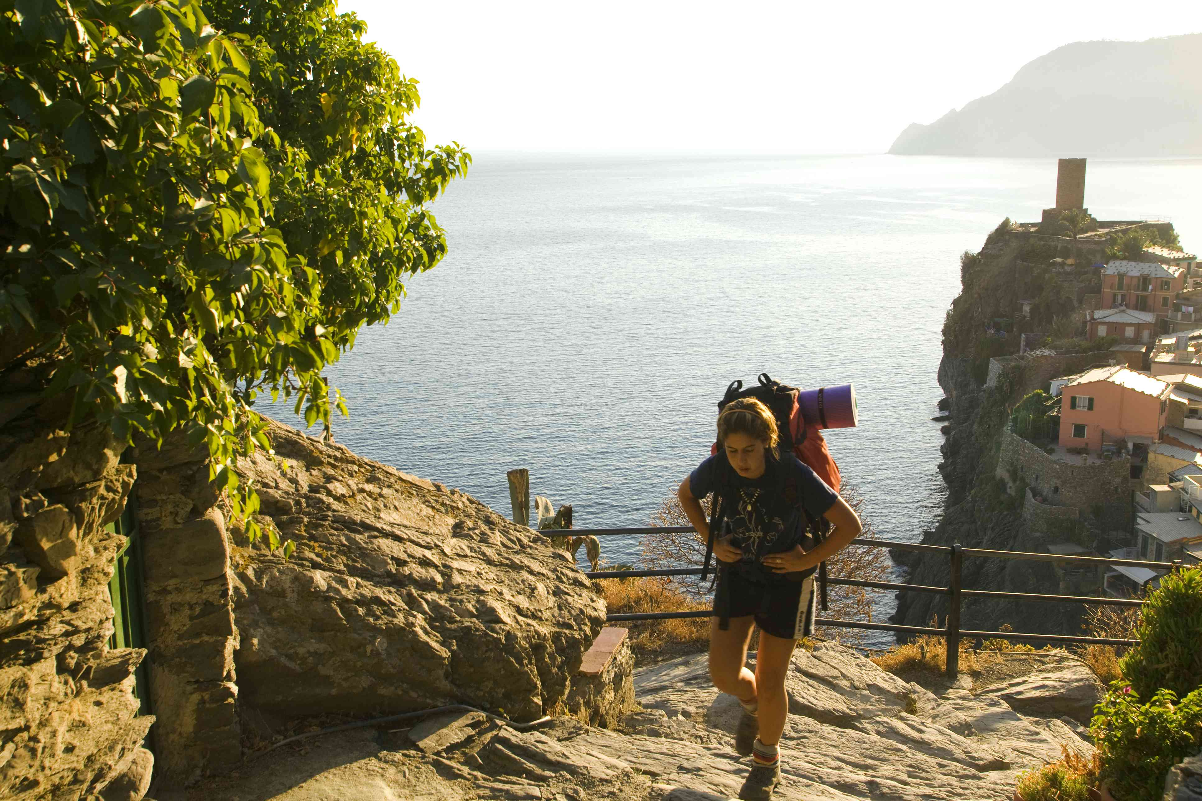 Person hiking uphill with a backpack, Cinque Terre National park