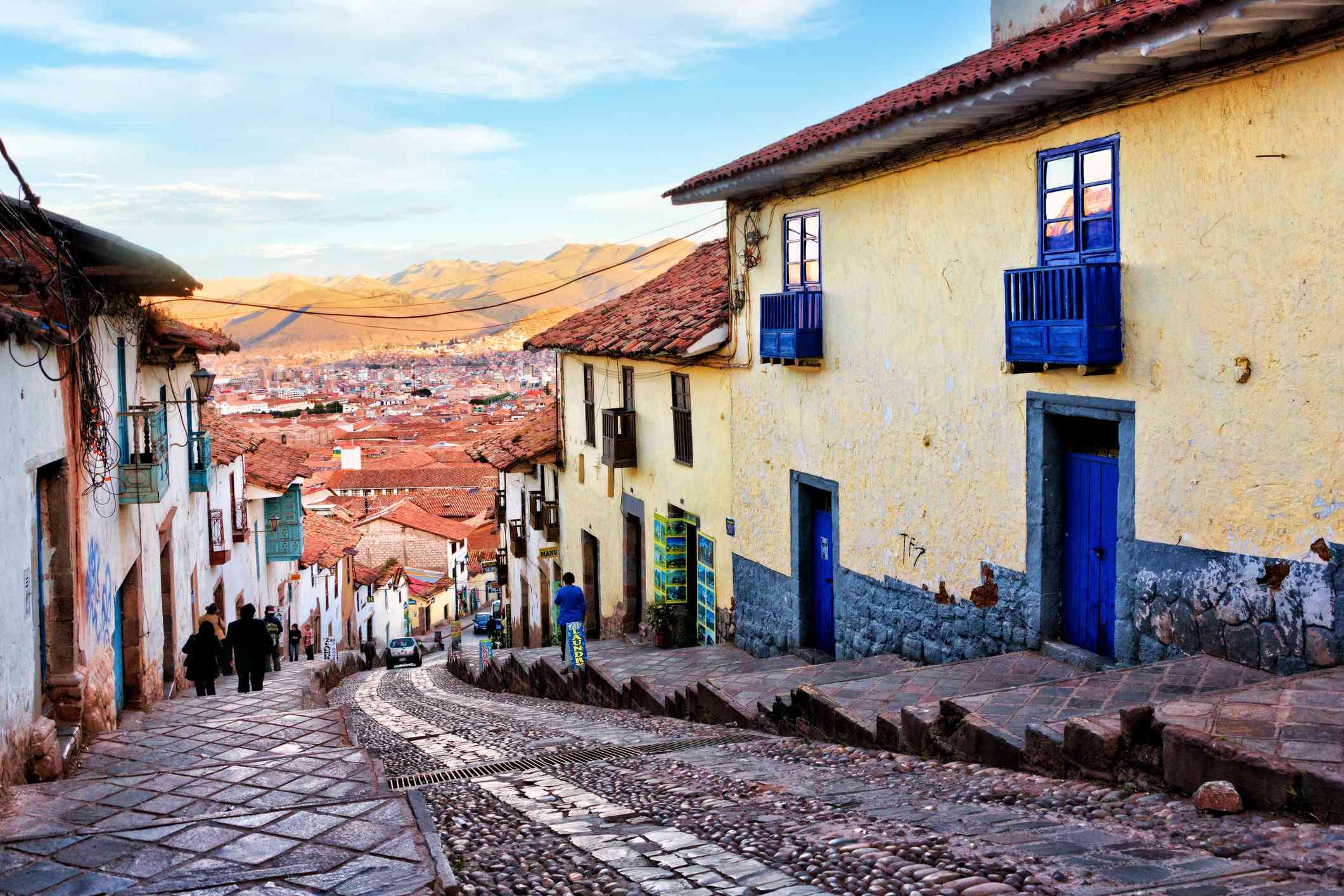 Historic architecture of Cusco along steep street northwest of Plaza de Armas, Peru
