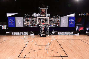 A NBA court in the Disney bubble with illustrated players running on the court