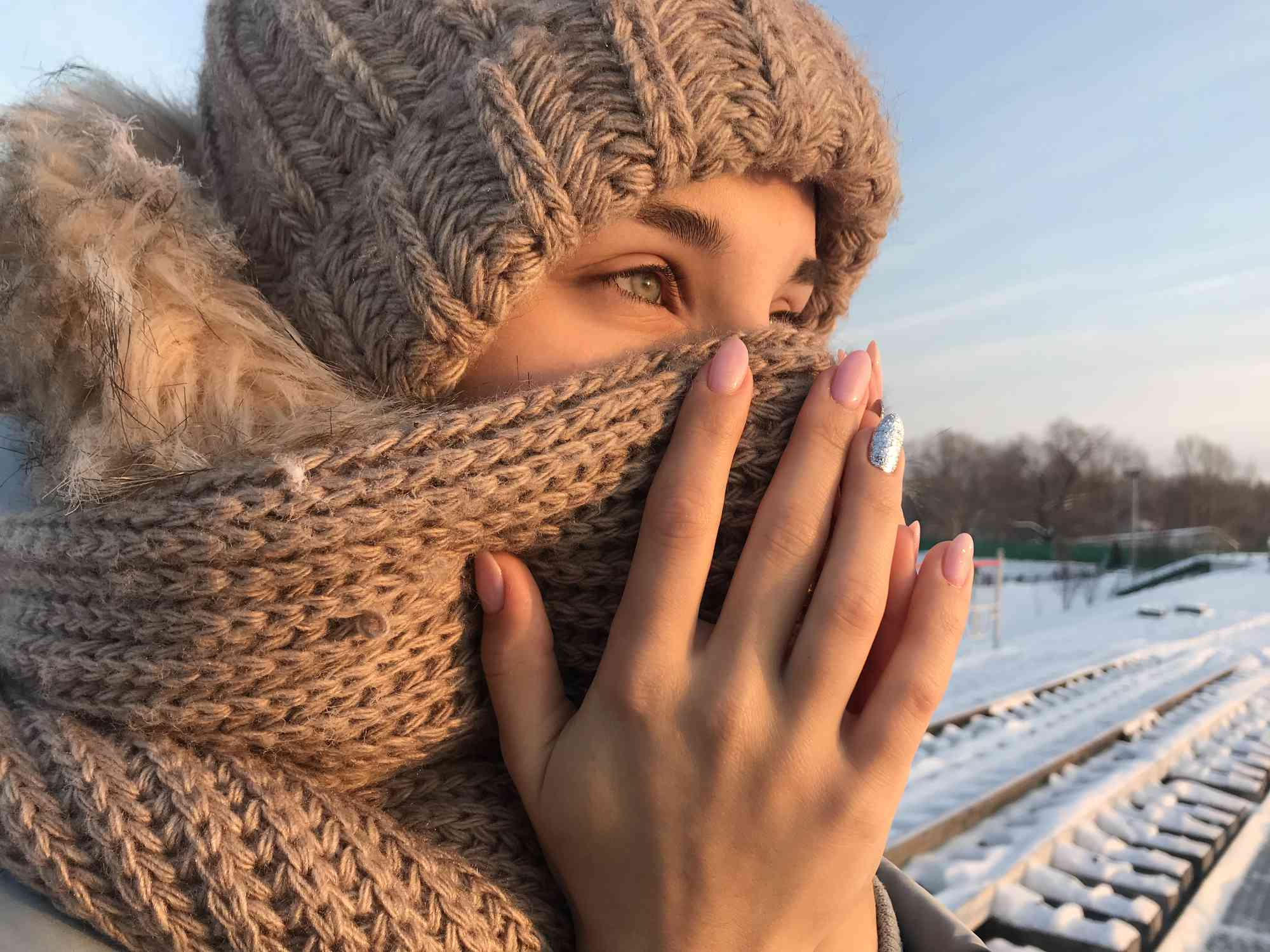 Close-Up Of Russian Woman in a Scarf While Standing On Field