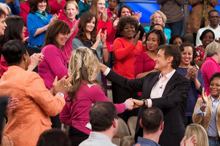 Dr. Oz greeting members of the audience
