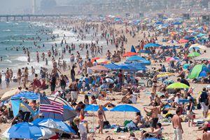 People sunbathing at Hermosa Beach on July 4