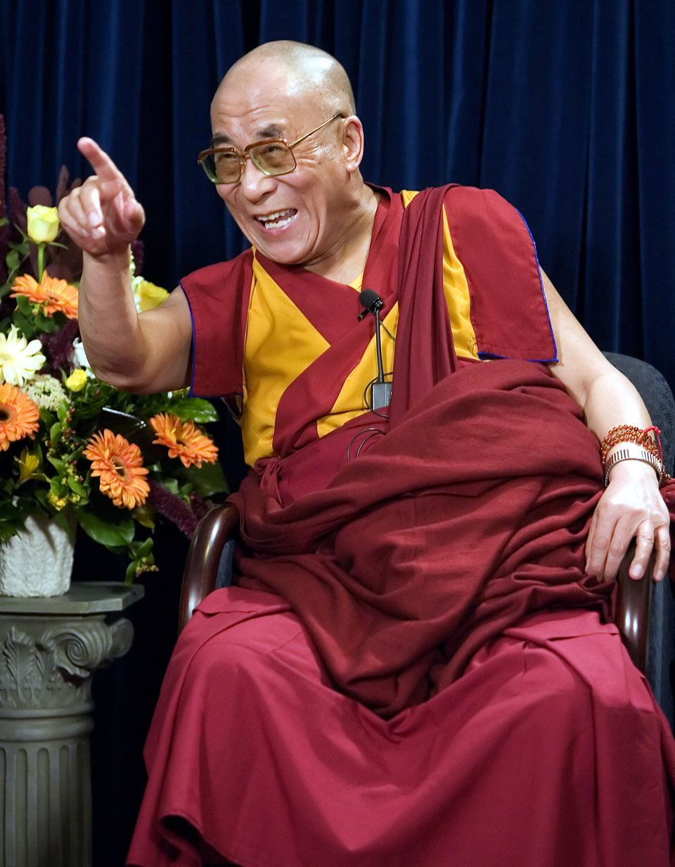 The 14th Dalai Lama laughing during an interview