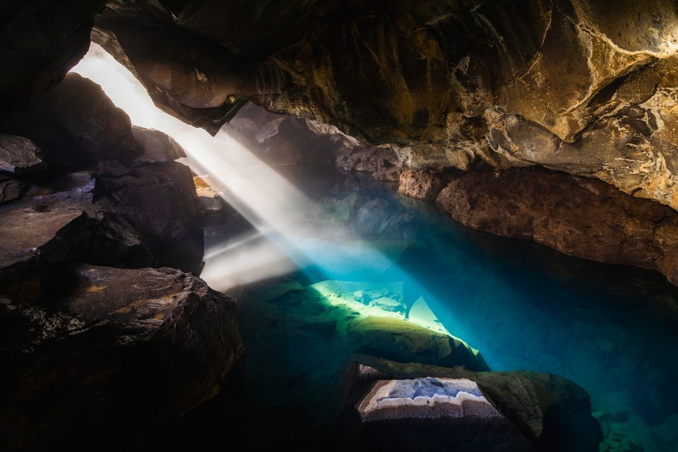 Grjotagja volcanic cave with an incredibly blue and hot thermal water near lake Myvatn