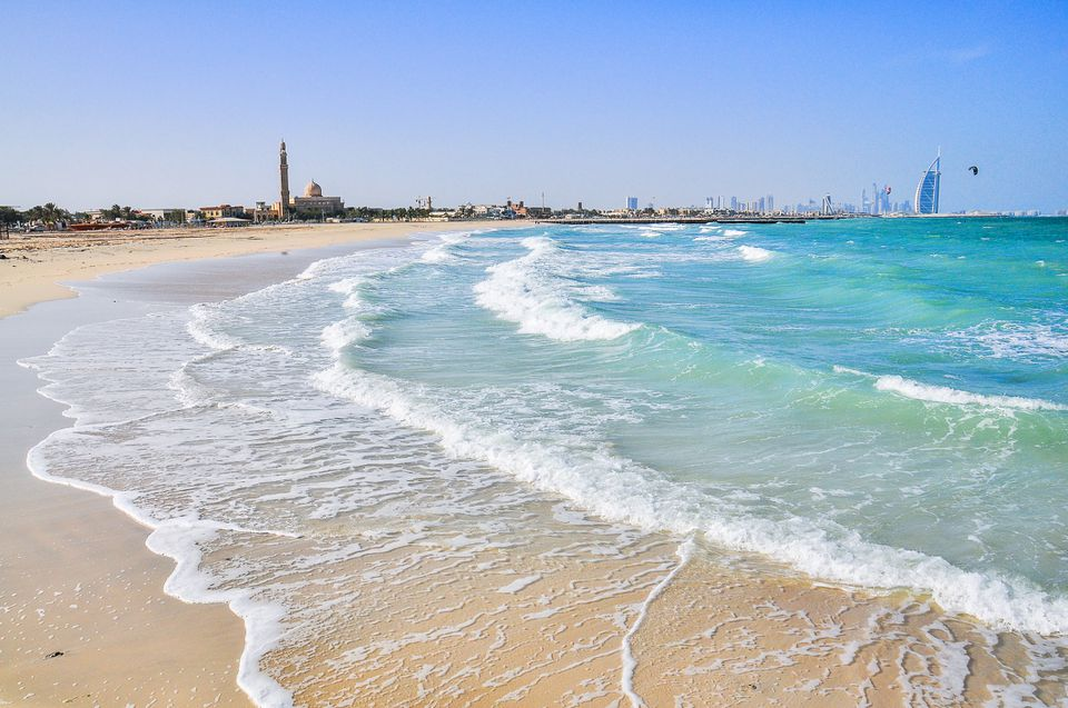 Dubai beach with city skyline in backfround