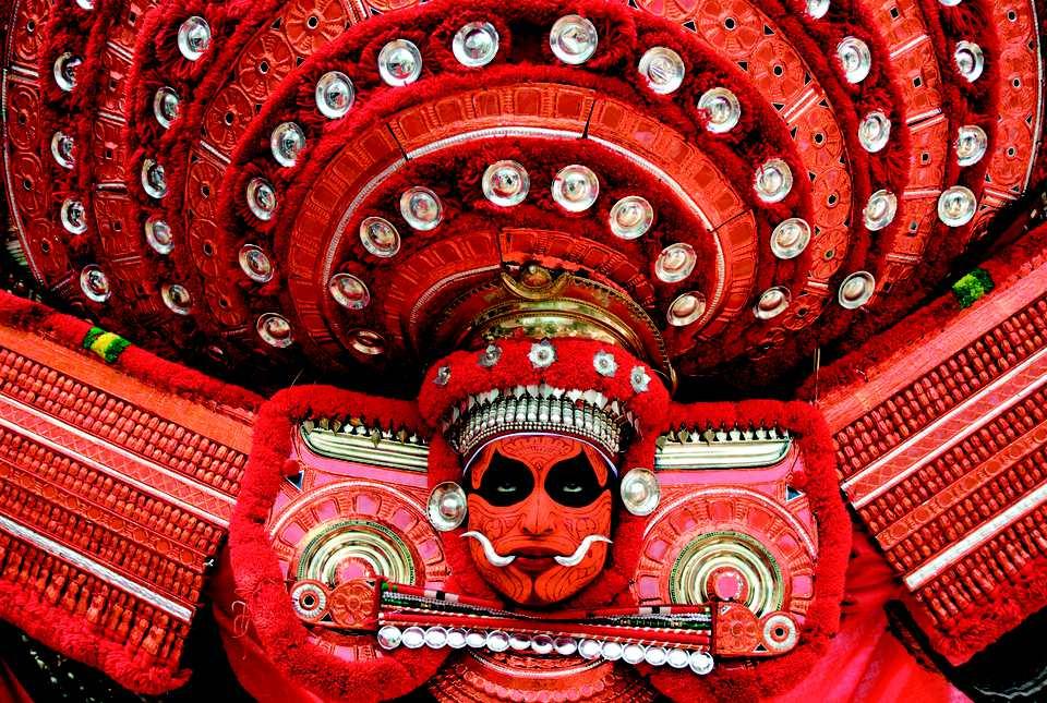 Theyyam performer.