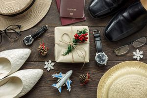 Gift surrounded by travel gear