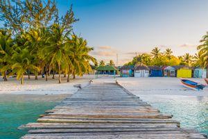 Wooden pier to a tropical beach, Saona island