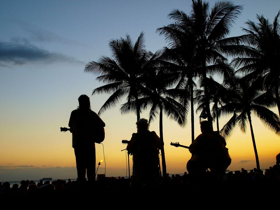 Hawaiian music band under palm trees sunset
