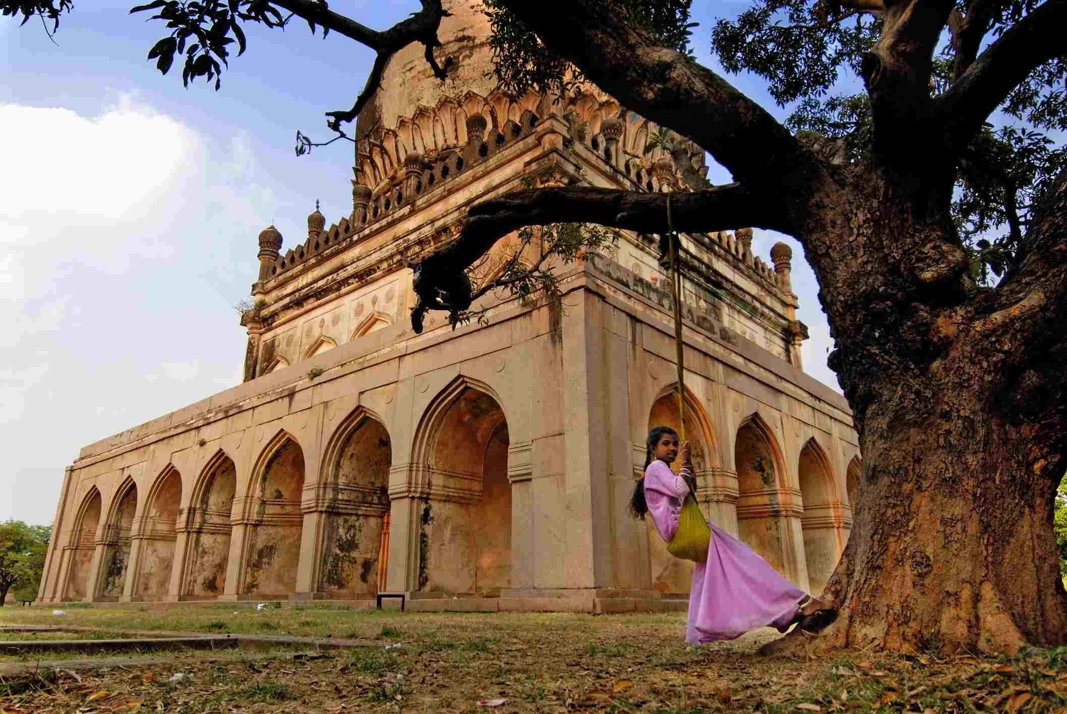 Girl on swing at tombs of Qutab Shahi kings.