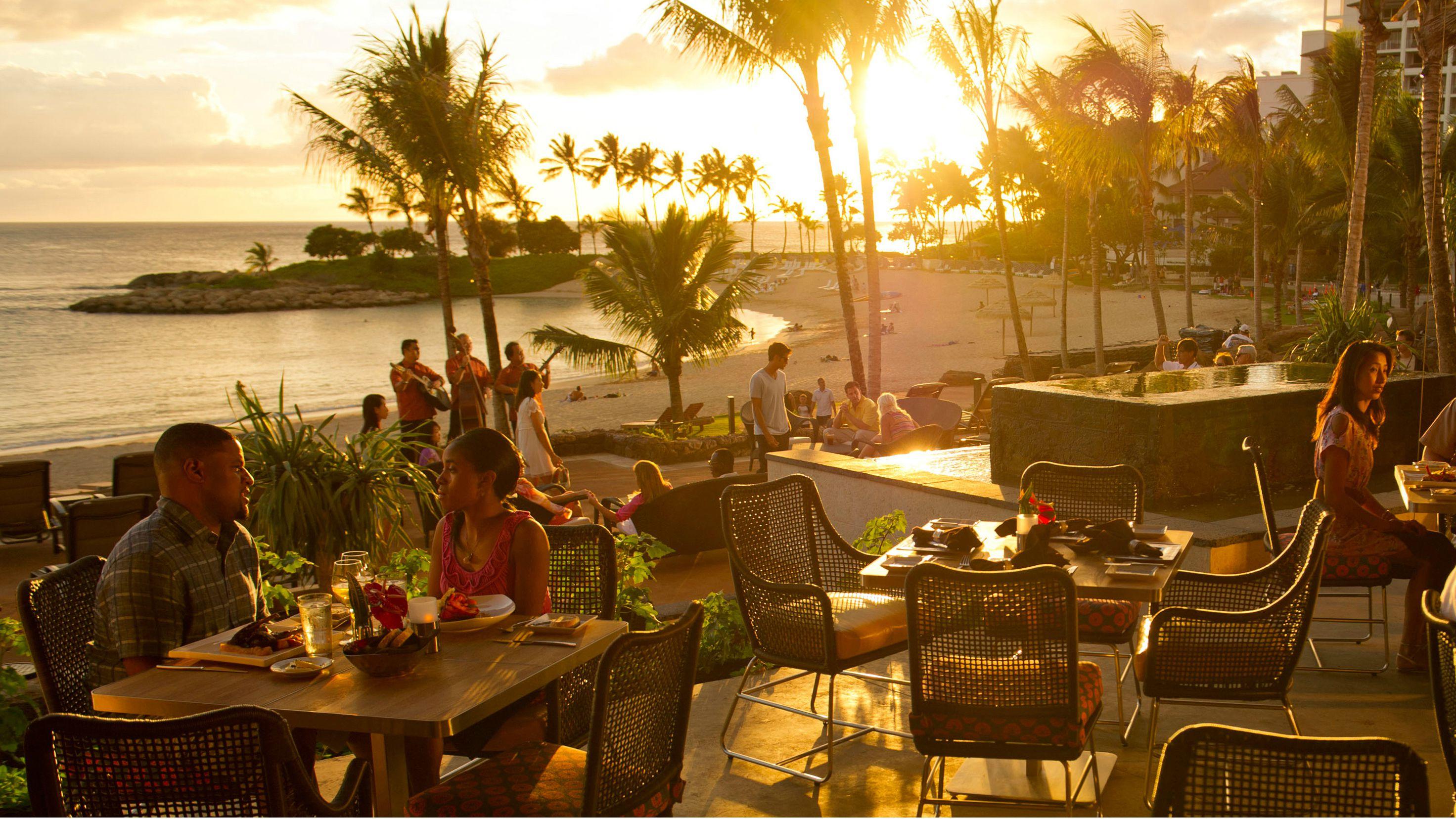 AMA'AMA restaurant at sunset overlooking the beach