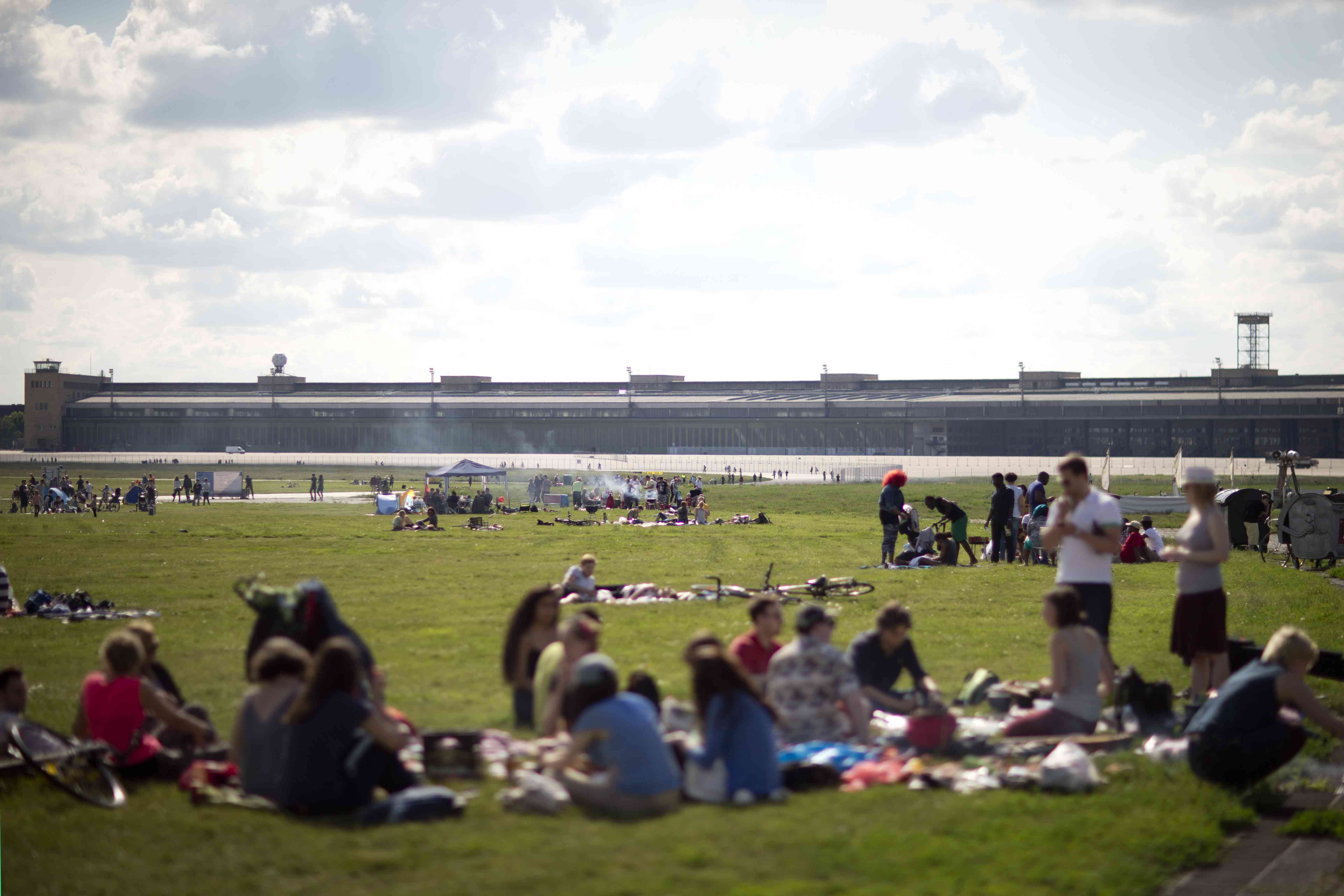 People barbecue in the park Tempelhofer Feld