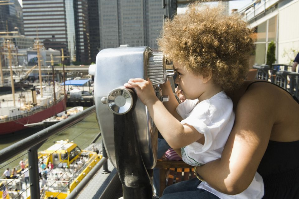 Child looking through telescope