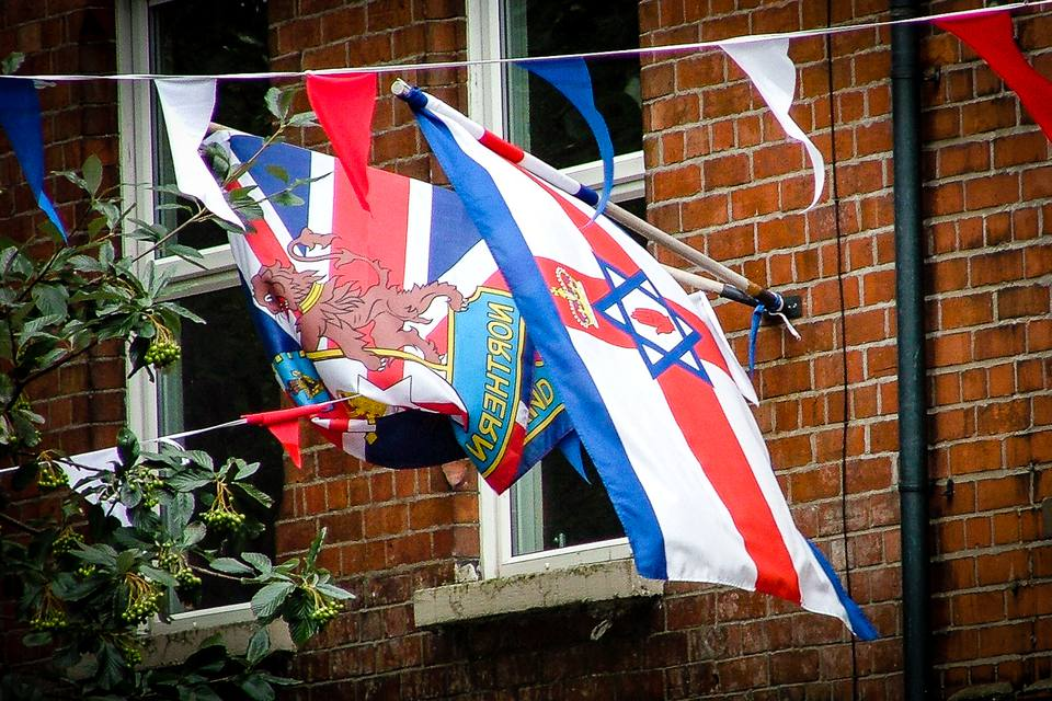 Confusion - in Northern Irish iconography, the Israeli flag may often be combined with the old one of Northern Ireland - do not expect any Jews to live in this house, a staunch Presbyterian would be a better bet