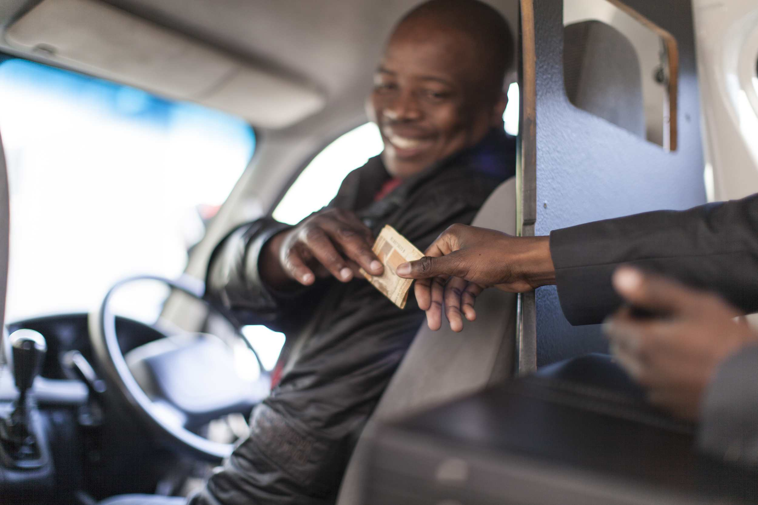 African businessman paying the taxi driver, Cape Town, South Africa