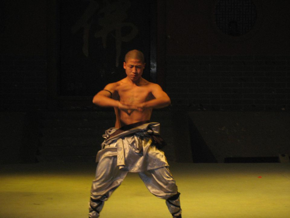 Shaolin monk performing at the Shaolin Temple Performance Hall.