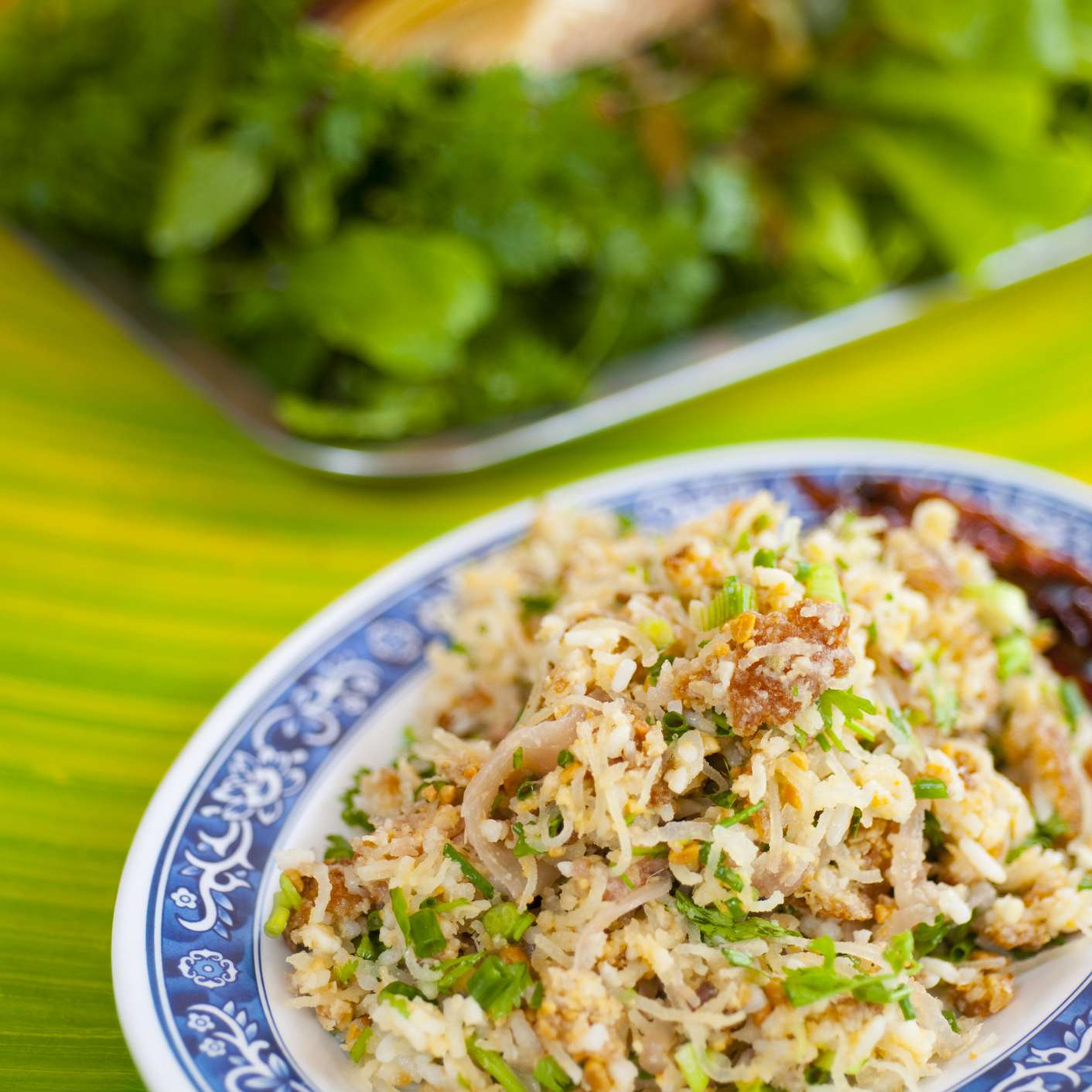 Dish of naem khao, salad of rice and fermented pork, at restaurant.